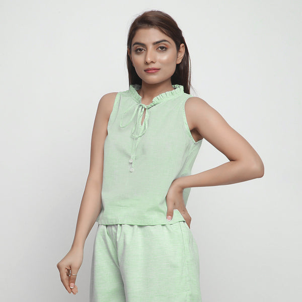 Front View of a Model wearing Mint Green Cotton Ruffled A-Line Top