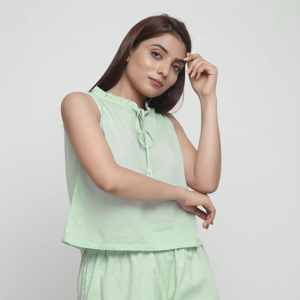 Right View of a Model wearing Mint Green Cotton Chambray A-Line Top