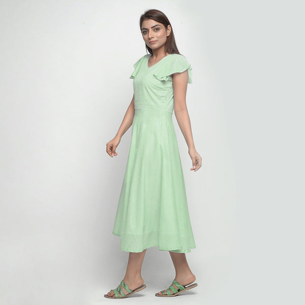 Left View of a Model wearing Mint Green Cotton Chambray Fit and Flare Dress