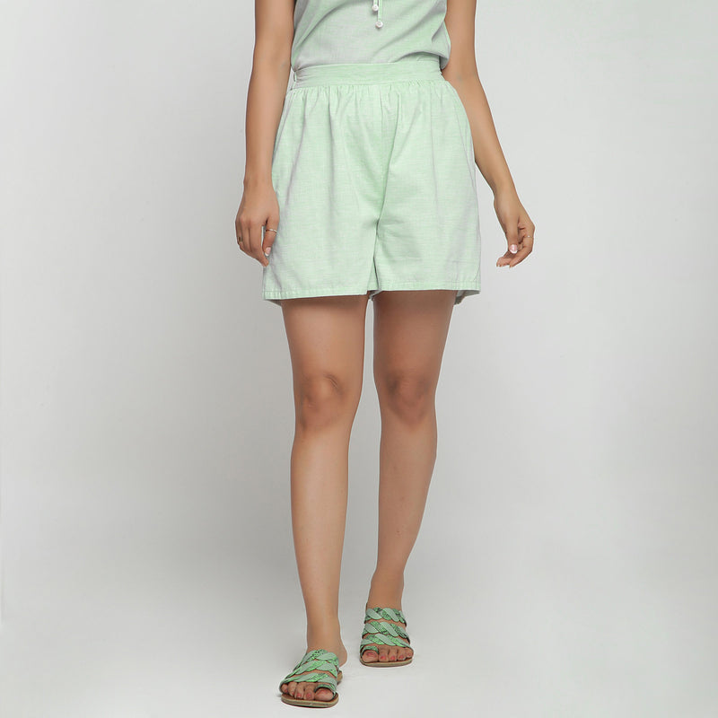 Front View of a Model wearing Mint Green Cotton Chambray Shorts