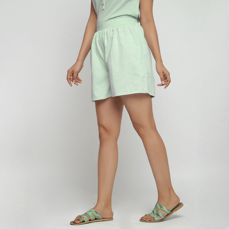 Left View of a Model wearing Mint Green Cotton Chambray Shorts