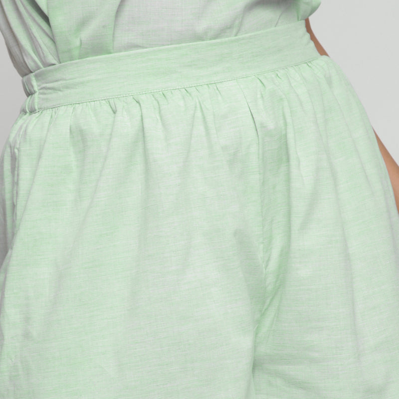 Front Detail of a Model wearing Mint Green Cotton Chambray Shorts