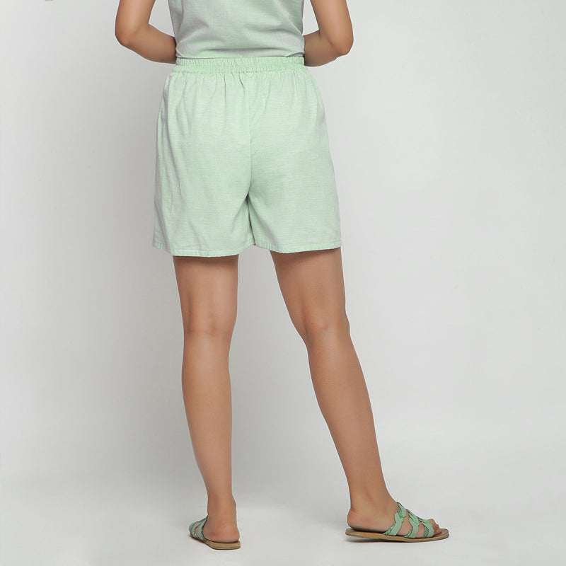 Back View of a Model wearing Mint Green Cotton Chambray Shorts
