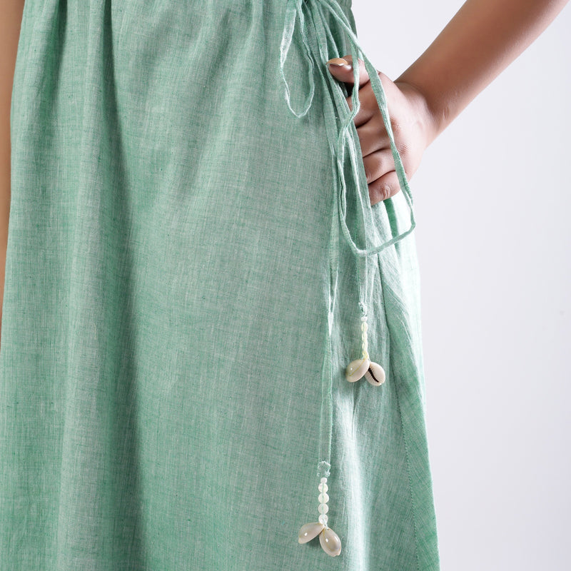 Left Detail of a Model wearing Green Handspun Strappy Circular Dress