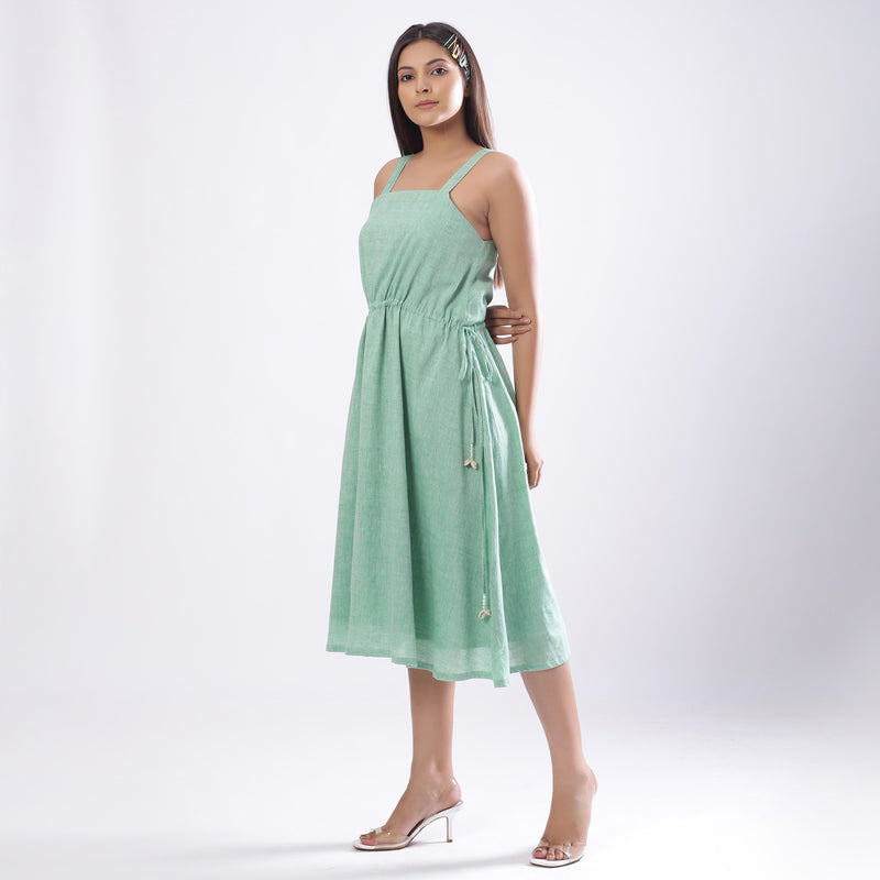 Left View of a Model wearing Green Handspun Strappy Circular Dress