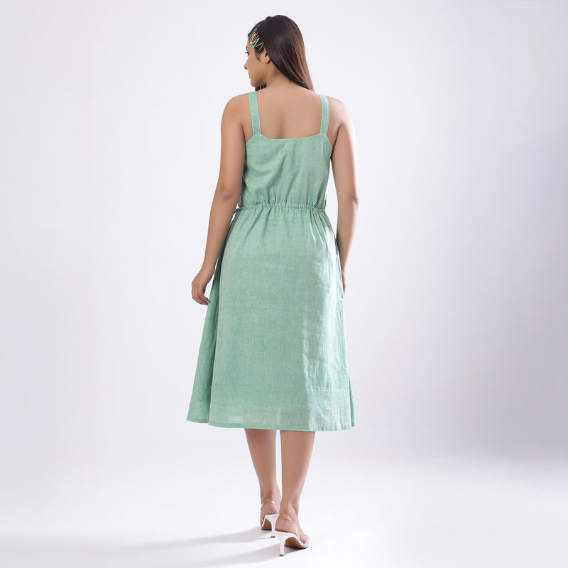 Back View of a Model wearing Green Handspun Strappy Circular Dress