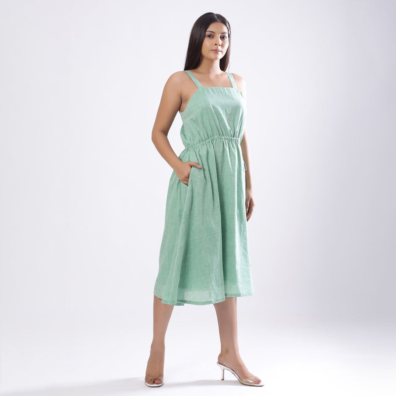 Right View of a Model wearing Green Handspun Strappy Circular Dress