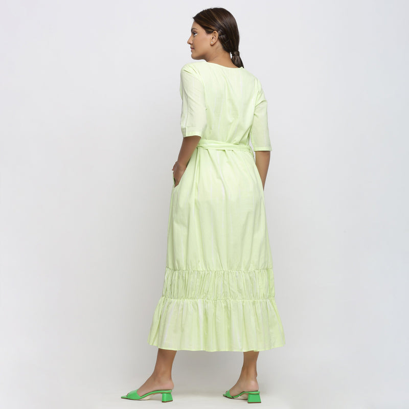 Back View of a Model wearing Mint Green Tie and Dye Tiered Dress