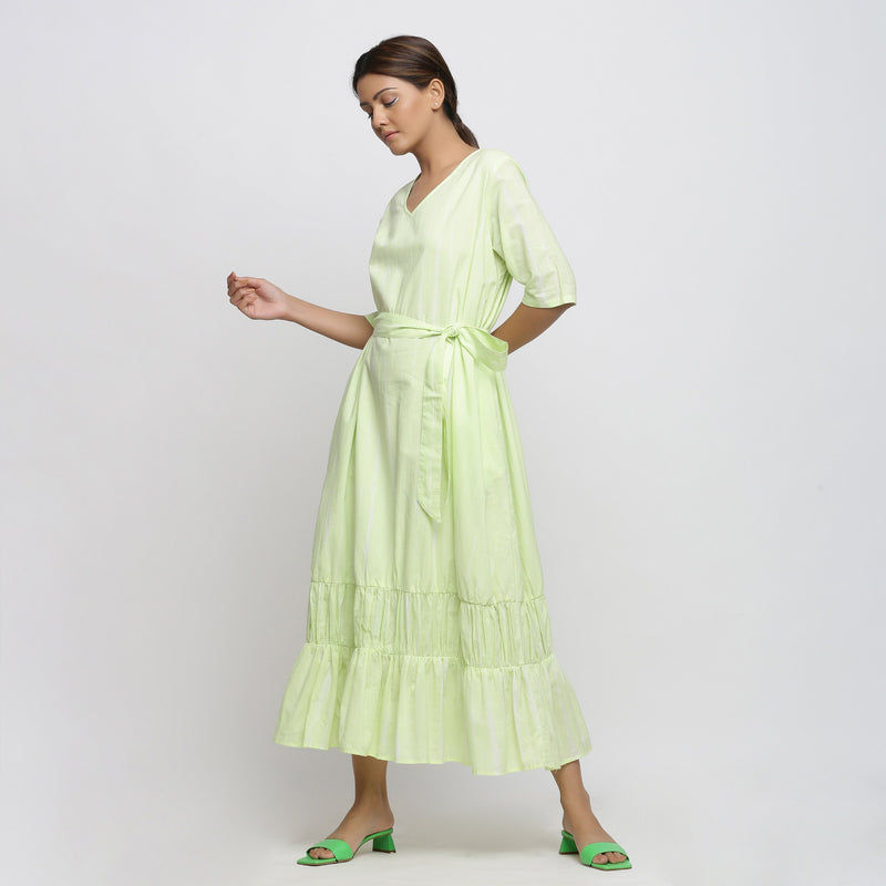 Left View of a Model wearing Mint Green Tie and Dye Tiered Dress