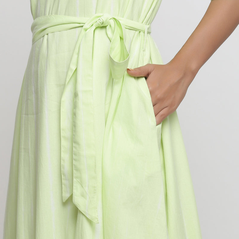 Left Detail of a Model wearing Mint Green Tie and Dye Tiered Dress