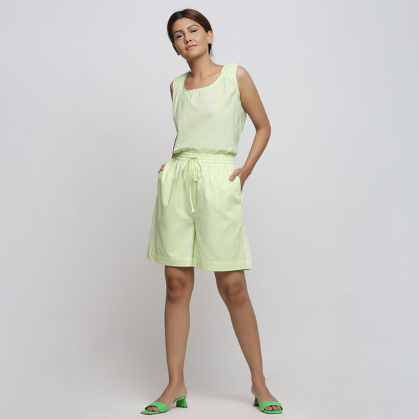 Front View of a Model wearing Mint Green Tie & Dye Bermuda Shorts