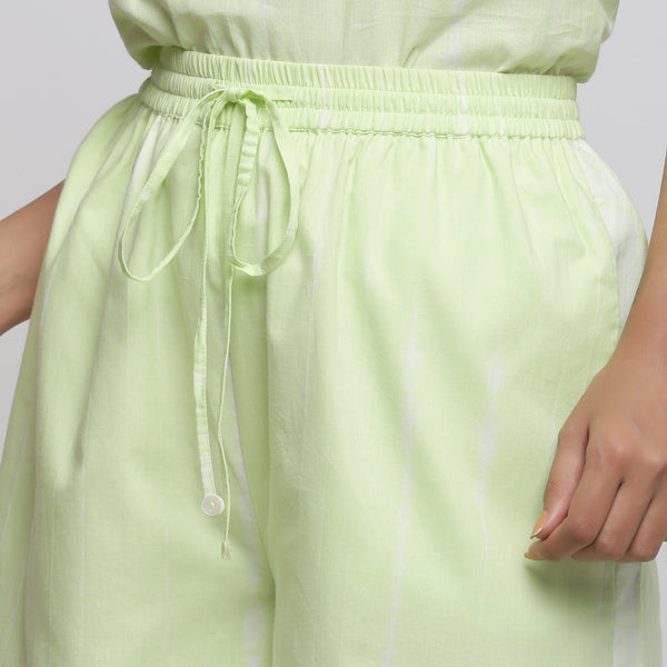 Front Detail of a Model wearing Mint Green Tie & Dye Bermuda Shorts