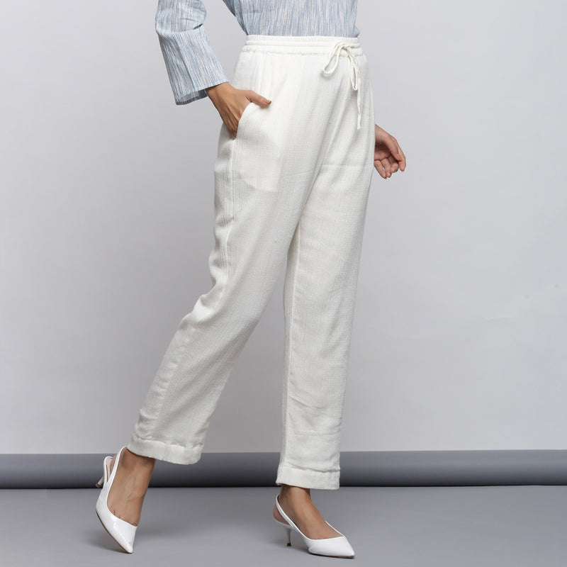 Front View of a Model wearing Off-White Crinkled Cotton Tapered Pant