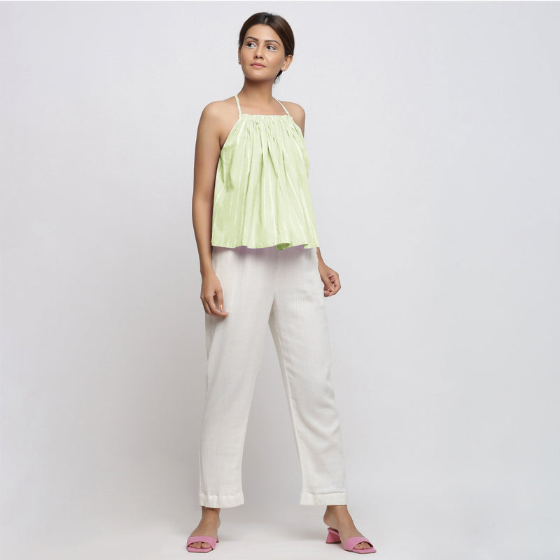 Front View of a Model wearing Mint Green Top and White Tapered Pant Set