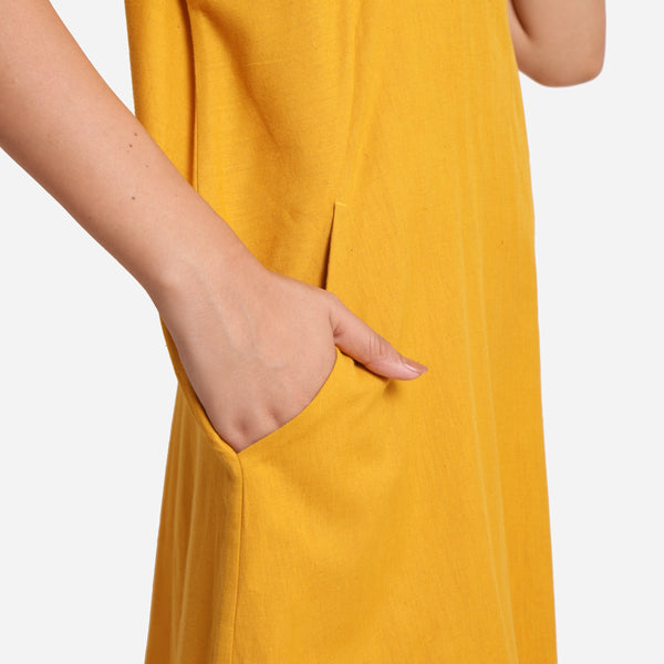 Right Detail of a Model wearing Mustard Cotton Flax Anti-Fit Dress