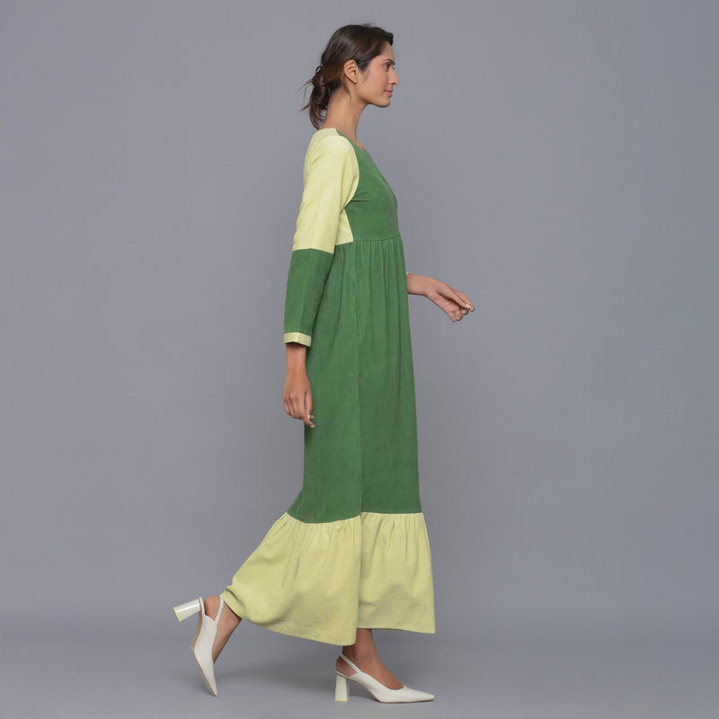 Right View of a Model wearing Moss Green Corduroy Tier Gathered Dress