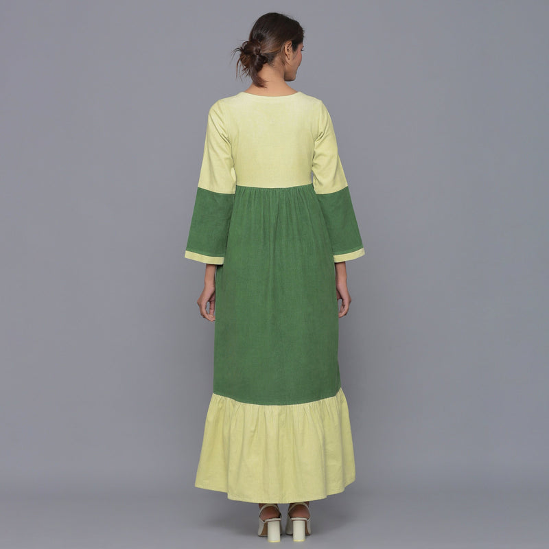 Back View of a Model wearing Moss Green Corduroy Tier Gathered Dress