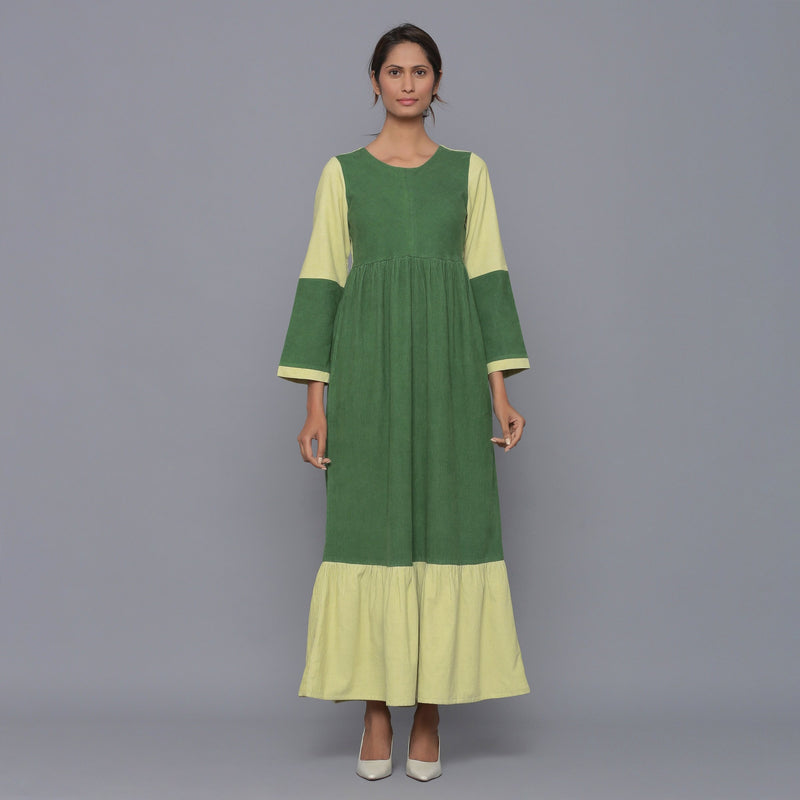 Front View of a Model wearing Moss Green Corduroy Tier Gathered Dress