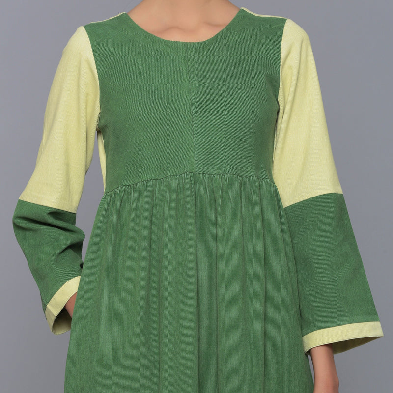 Front Detail of a Model wearing Moss Green Corduroy Tier Gathered Dress