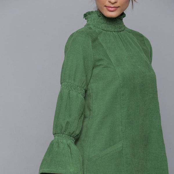 Front Detail of a Model wearing Moss Green Corduroy High Neck Dress
