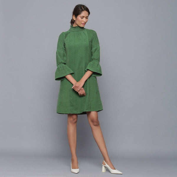 Front View of a Model wearing Moss Green Corduroy High Neck Dress