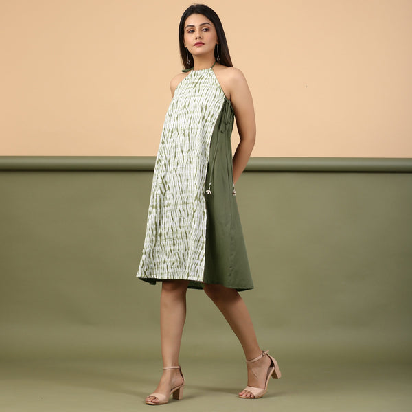 Left View of a Model wearing Moss Green Shibori Halter Neck A-Line Dress