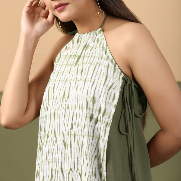 Front Detail of a Model wearing Moss Green Shibori Halter Neck A-Line Dress