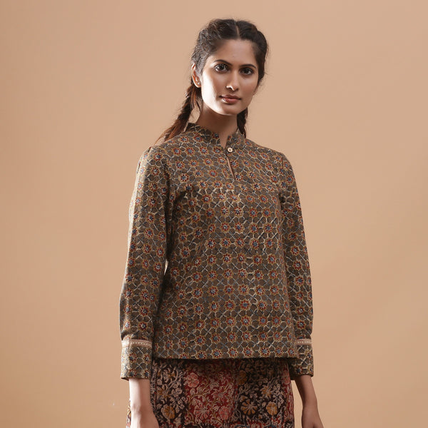Front View of a Model wearing Muddy Green Kalamkari Warm Shirt