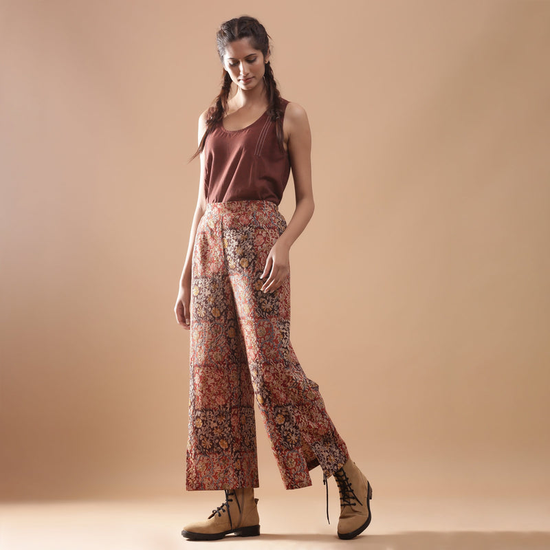 Left View of a Model wearing Muddy Red Wide-Leg Kalamkari Slit Pant