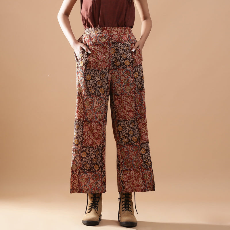 Front View of a Model wearing Muddy Red Wide-Leg Kalamkari Slit Pant