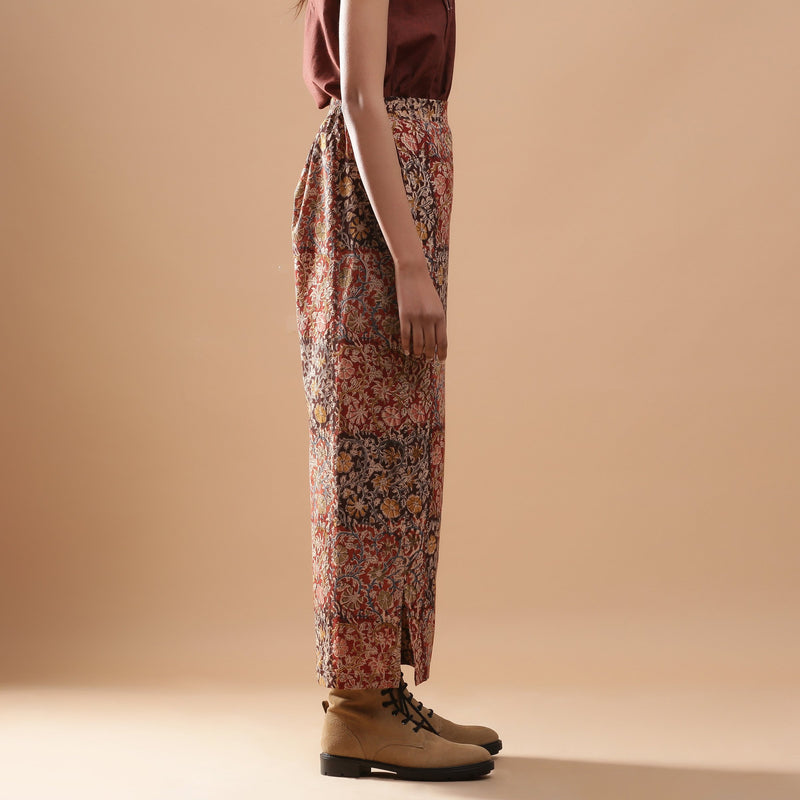 Right View of a Model wearing Muddy Red Wide-Leg Kalamkari Slit Pant
