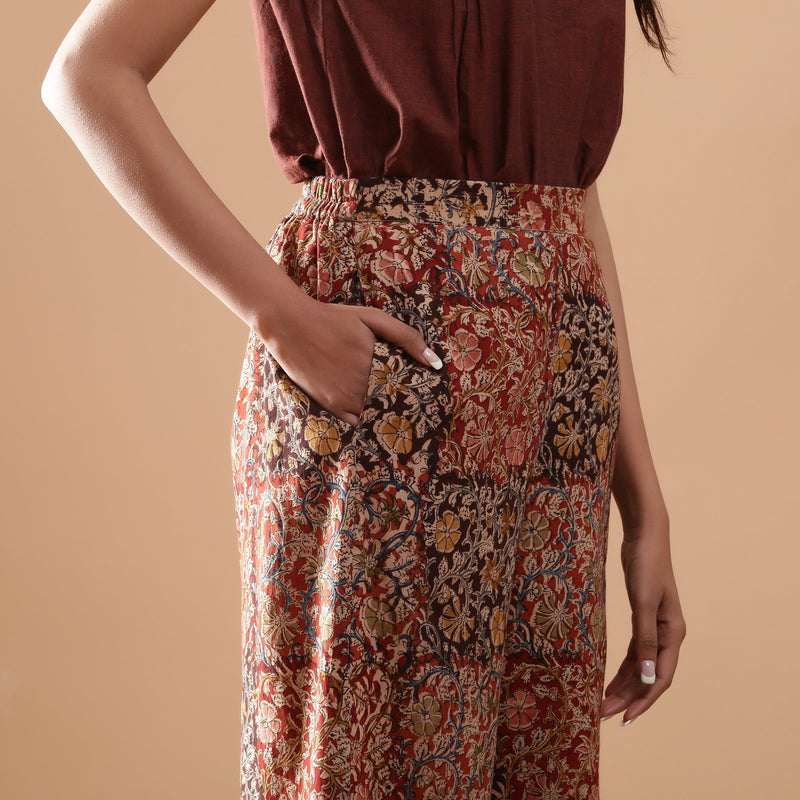 Right Detail of a Model wearing Muddy Red Wide-Leg Kalamkari Slit Pant