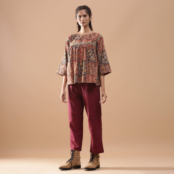 Front View of a Model wearing Muddy Red Kalamkari Flannel Floral Top