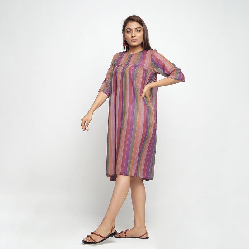 Left View of a Model wearing Multicolor Handwoven Gathered Dress