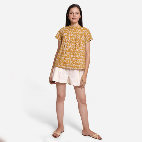 Front View of a Model wearing Mustard Bagru Print Relaxed Fit Top