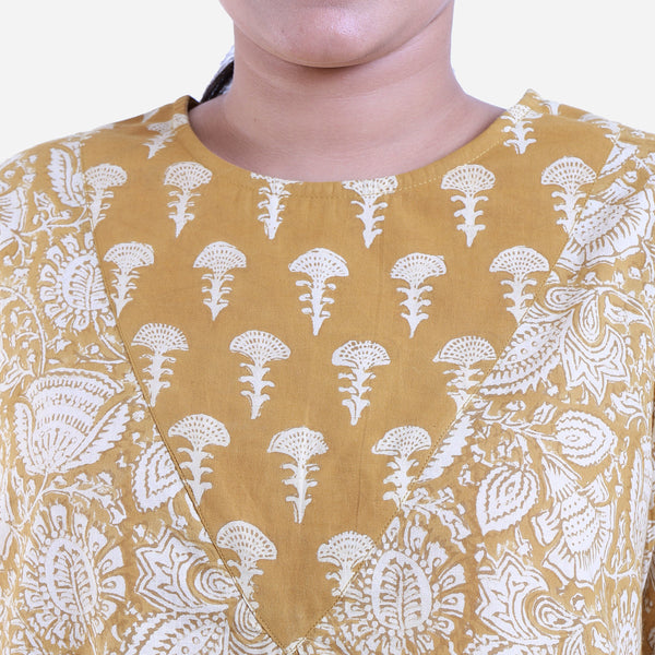 Front Detail of a Model wearing Mustard Bagru Printed Flared Top