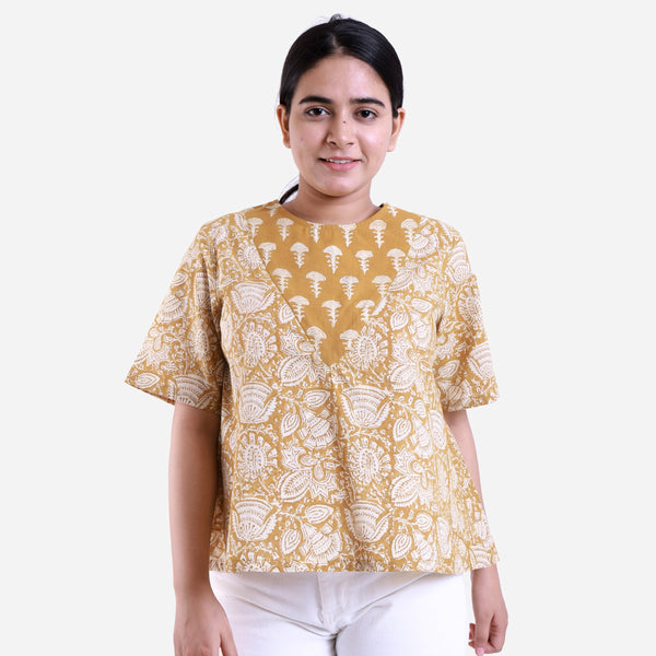 Front View of a Model wearing Mustard Bagru Printed Flared Top