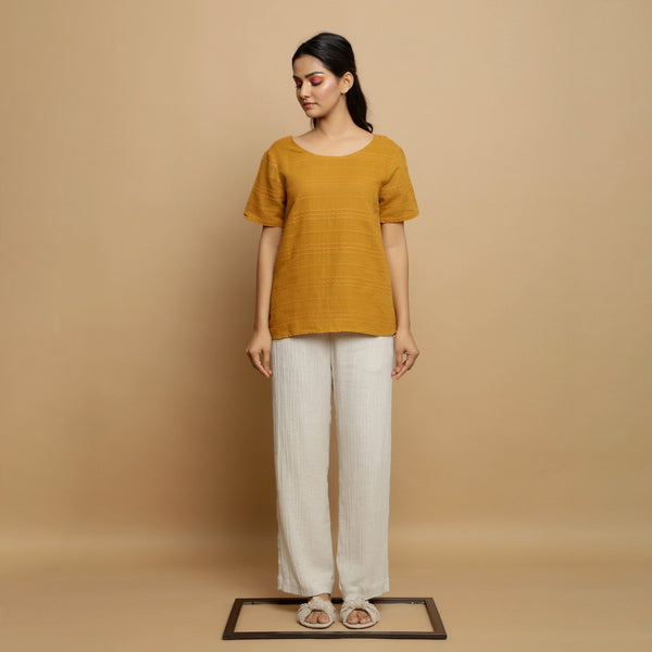 Front View of a Model wearing Mustard Handwoven Cotton U-Neck Straight Top