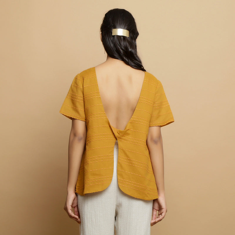 Back View of a Model wearing Mustard Handwoven Cotton U-Neck Straight Top