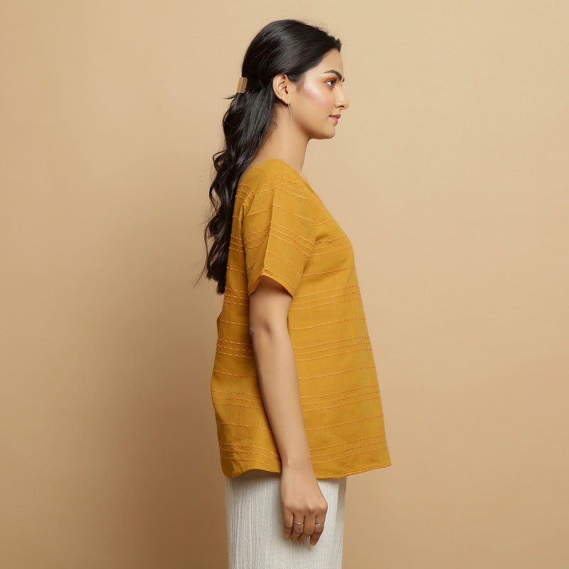 Right View of a Model wearing Mustard Cotton U-Neck Straight Top