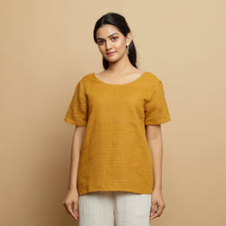 Front View of a Model wearing Mustard Cotton U-Neck Straight Top