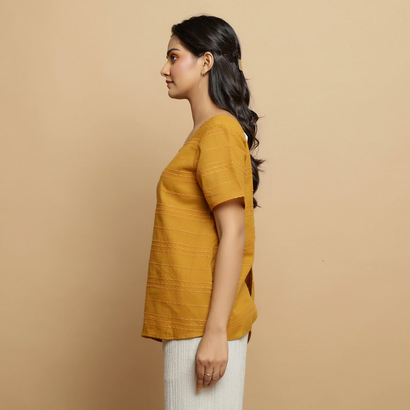 Left View of a Model wearing Mustard Cotton U-Neck Straight Top