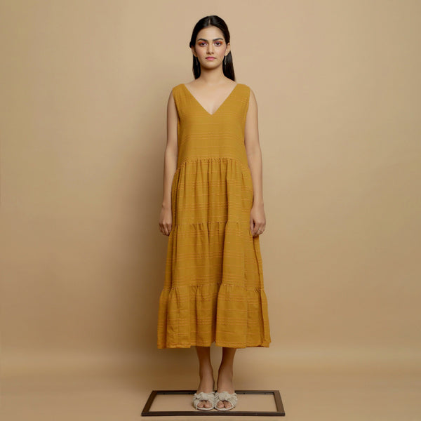 Front View of a Model wearing Mustard Handwoven Gathered Tier Dress