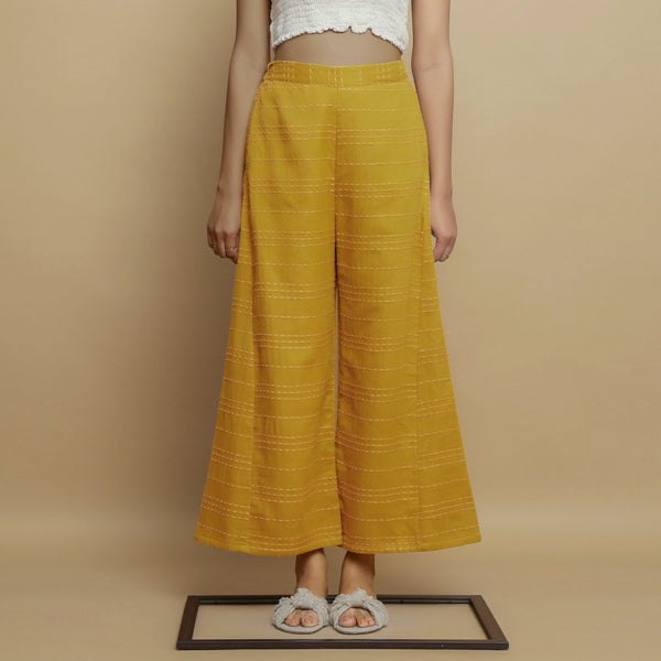 Front View of a Model wearing Mustard Paneled Striped Handwoven Pant