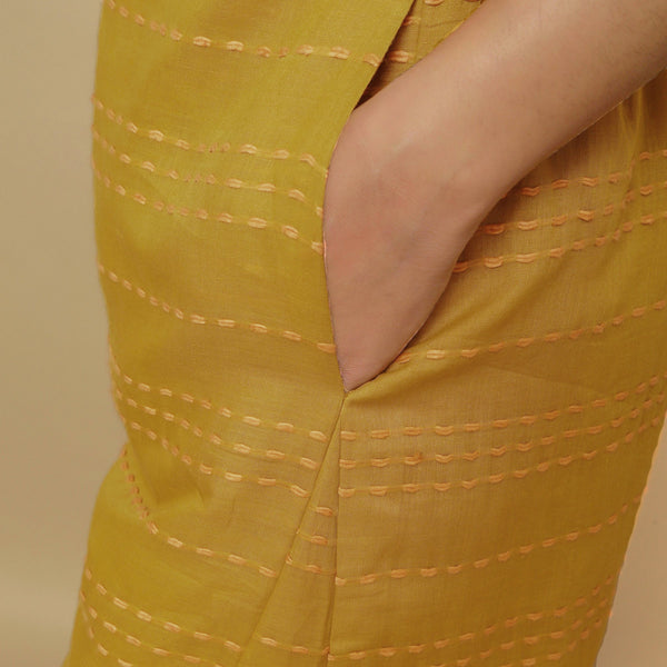 Left Detail of a Model wearing Mustard Handwoven Paneled Pant