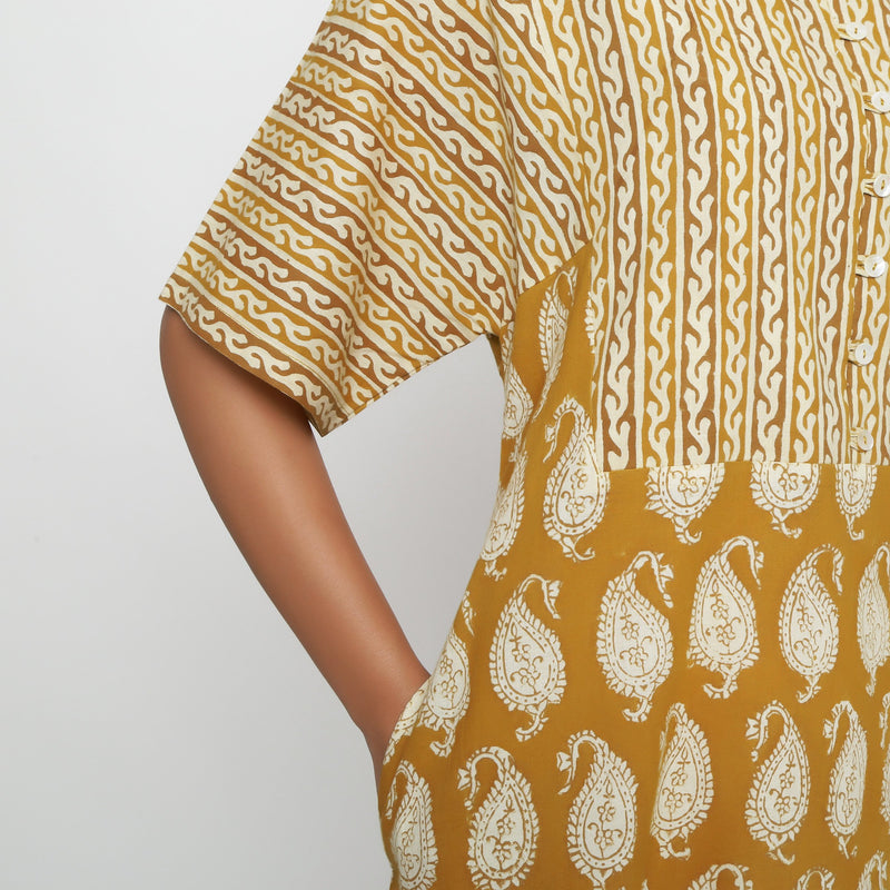 Front Detail of a Model wearing Mustard Block Printed Snug Dress