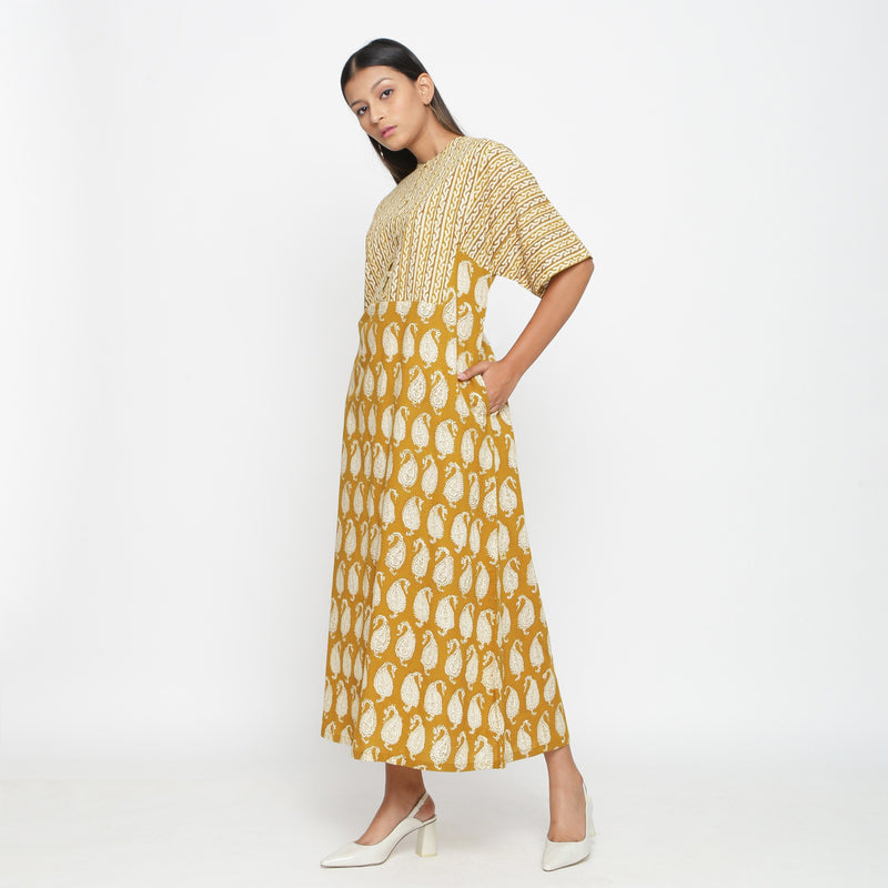 Left View of a Model wearing Mustard Block Printed Snug Dress