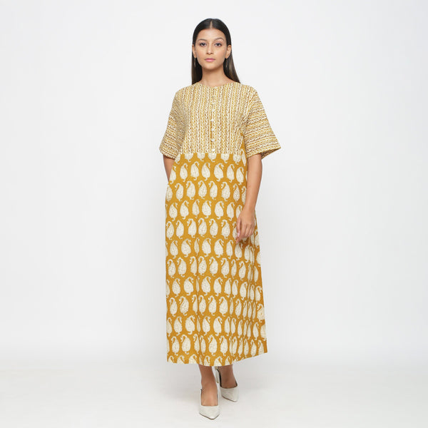 Front View of a Model wearing Mustard Block Printed Snug Dress