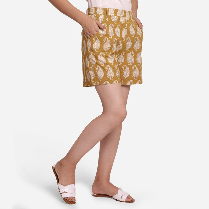 Right View of a Model wearing Bagru Block Print Mustard Straight Shorts