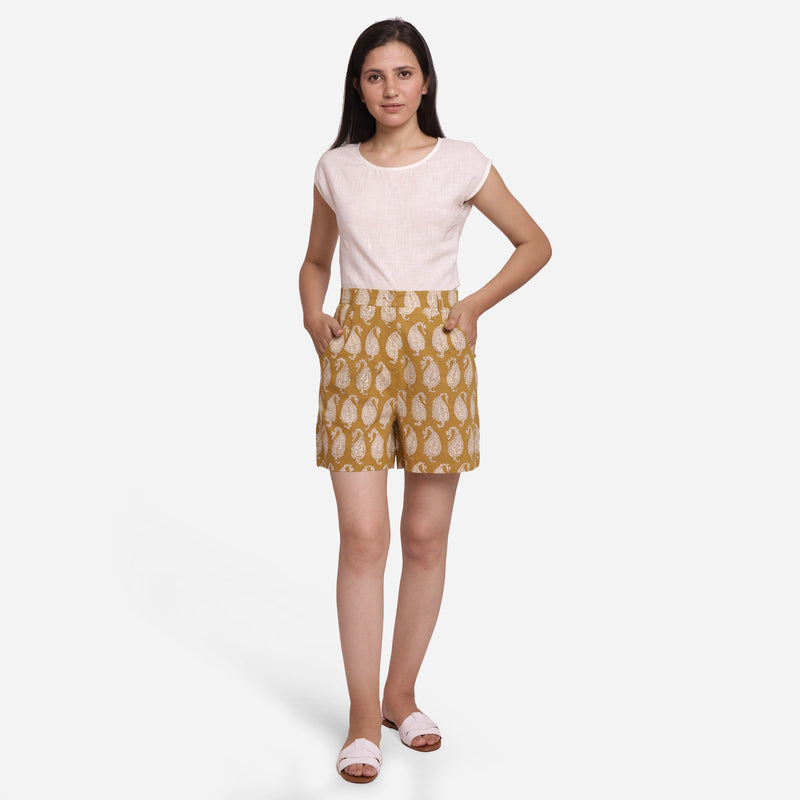 Front View of a Model wearing Bagru Block Print Mustard Straight Shorts
